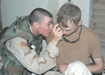 Specialist Town gets his ears examined after a rocket blast.