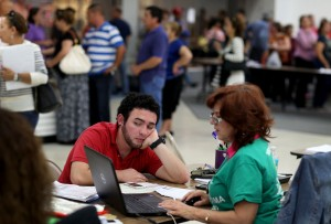 Americans register for health insurance at an ACA event.