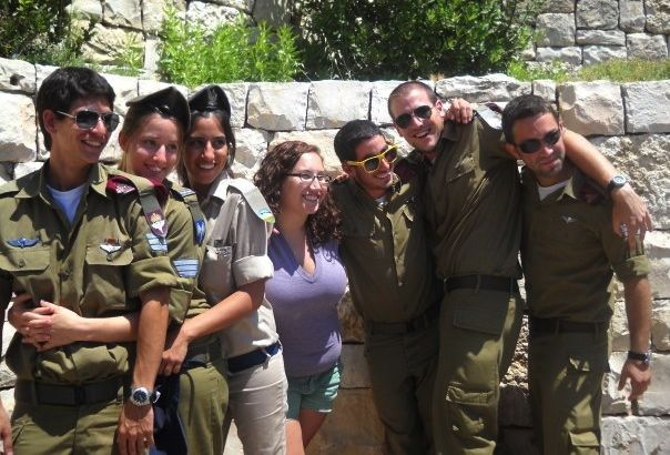 A Birthright Israel participant flanked by Israeli soldiers   Credit: LAUREN VASSERMAN