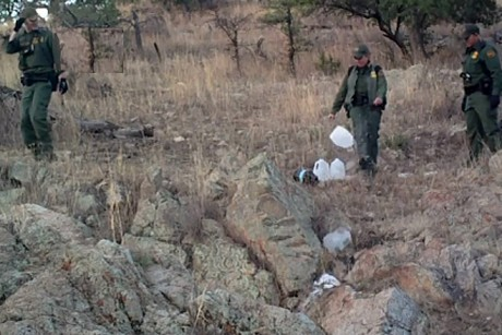 A hidden camera set up by the group No More Deaths shows Border Patrol agents destroying water left in the desert for migrants to drink. | Credit: THE NATION INSTITUTE COURTESY OF NO MORE DEATHS