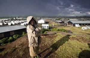 A boy stands at Kibati refugee camp for internally displaced people in North Kivu in DR Congo.   Credit: SVEN TORFINN/MEDECINS SANS FRONTIERS