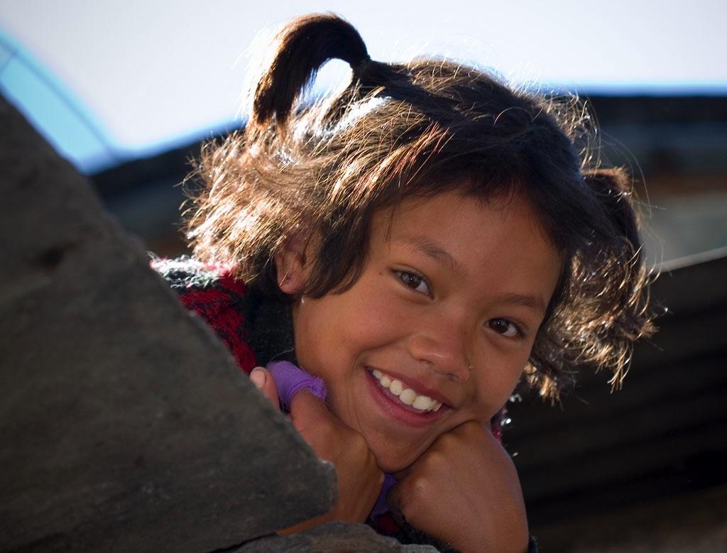 Smiling Nepalese girl from Tatopani   Credit: COURTESY DEY ALEXANDER