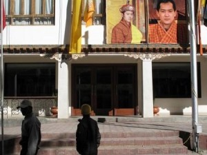 The royal family, father and son, overlooking a Thimphu street   Credit: DON DUNCAN