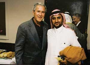 Sheikh Eifan Saddun al-Isawi with George W. Bush | Credit: SHANE BAUER