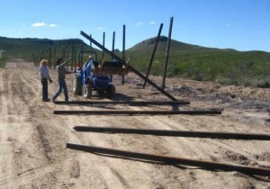 Minutemen work to construct a fence. | Credit: MINUTEMEN CIVIL DEFENSE CORPS