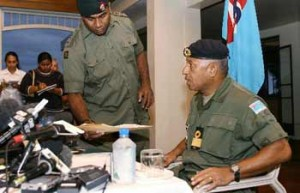Fiji military commander Voreqe Bainimarama (right), with Fiji Water, during a press conference in Suva December 4, 2006 | Credit: XINHUA/AFP