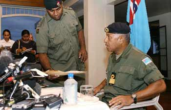 Fiji military commander Voreqe Bainimarama (right), with Fiji Water, during a press conference in Suva December 4, 2006   Credit: XINHUA/AFP