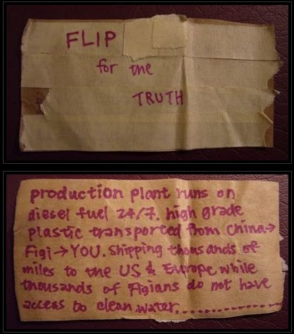 A notice pasted to a bottle of Fiji Water at a Whole Foods in New York on February 25, 2010 | Credit: JEFFREYTWENTYSEVEN