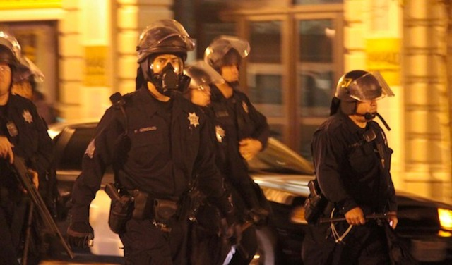 Sgt. Patrick Gonzales (center) at the Oct. 25 raid on Occupy Oakland. Gonzales has shot four suspects, three fatally, in his 13-year career.   Credit: ALI WINSTON