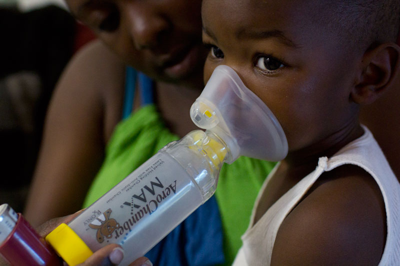 Latricia Jones' son, Dre'vyon, age two, needs daily breathing treatments to relieve his chronic asthma. Corpus Christi, Texas. | Credit: JENNIFER REEL