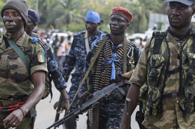 Rebel soldiers loyal to Ivory Coast opposition leader Alassane Ouattara, the widely recognized winner of an election that millions once hoped would reunite the West African nation, advance towards Government soldiers...   Credit: COURTESY THE HINDU