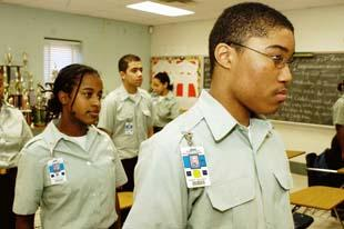 Freshman Joseph Crocket (right) stands at attention as role call is taken at the Forestville Military Academy in Maryland. Students there do push-ups when they break the rules.   Credit: IN THESE TIMES