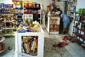 The scene after a 68-year-old shop owner is gunned down in Praxedis G. Guerrero in May 2008. | Credit: COURTESY JULIAN CARDONA