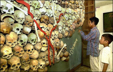 A man shows the skulls of Khmer Rouge victims to a boy in Tuolsleng Genocide Museum in Phnom Penh.   Credit: COURTESY DISMAL WORLD