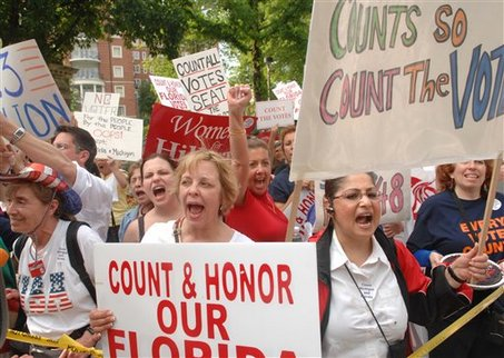 Demonstrators in Washington march outside of the Democratic National Rules and Bylaws Committee, 2008   Credit: AP