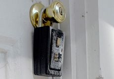 Locks and spider webs on the entrance door of a foreclosed Atlanta home | Credit: GREGORY SMITH/AP