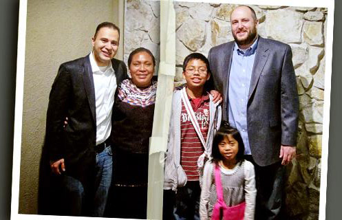 Together at last: Maria Luis with her children, Angelica and Daniel, and the lawyers who fought for her.