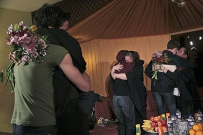 Josh Fattal, Sarah Shourd and Shane Bauer greet their mothers in Tehran in May | Credit: APTOPIX