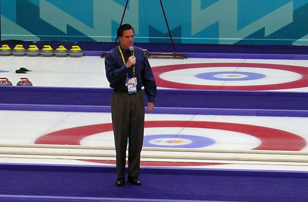 Mitt Romney offering remarks before a curling event at the 2002 Winter Olympics in Salt Lake City, Utah. | Credit: COURTESY MOTHER JONES/Uncleweed/Wikimedia commons