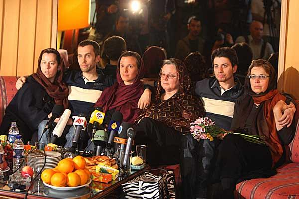 From left: Cindy Hickey and her son Shane Bauer, Sarah Shourd and her mother Nora Shourd, and Josh Fattal with his mother Laura Fattal at the Esteghlal hotel in Tehran on May 20. | Credit: AP