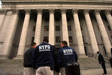 In this Nov. 17, 2009 file photo, members of the NYPD Counterterrorism unit talk outside the old federal courthouse in New York. | Credit: COURTESY MARY ALTAFFER/AP/FILE