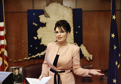 Gov. Sarah Palin stands in front of a map of Alaska.   Credit: BRIAN WALLACE/AP