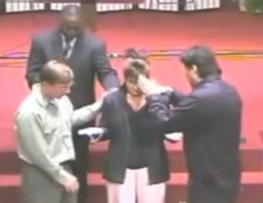Sarah Palin is shown accepting a special supernatural protection from witchcraft from Thomas Muthee.   Credit: IRREGULARTIMES.COM