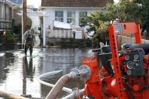US Service members supporting the Army Corps of Engineers and the Federal Emergency Management Agency's mission to allow access to flooded homes, pump up to a million gallons of water per day in Breezy Point, Qu... | Credit: US ARMY PHOTO BY MARY MARKOS