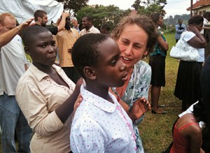 Pastor Lou Engle's associates lay hands on Ugandan attendees during TheCall event in May 2010. | Credit: COURTESY ADVOCATE