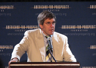 Stephen Moore speaks at an Americans for Prosperity Foundation event. His speaker fees average $7,500 to $10,000 a pop.   Credit: COURTESY ALTERNET
