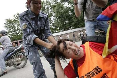 A police officer drags a Tibetan protester by his hair near the Chinese Embassy Visa Section in Kathmandu, June 27, 2008.   Credit: DEEPA SHRESTHA/REUTERS
