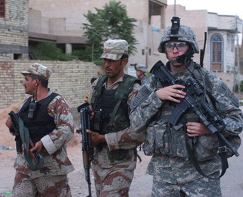 U.S. Army 2nd Lt. Evan Wolf, platoon leader for 2nd Platoon, Alpha Company (Engineers), 325th Brigade Special Troops Battalion, patrols alongside Iraqi army soldiers during a joint patrol through Baghdad, Iraq, June ... | Credit: U.S. ARMY/SGT. JEFFREY ALEXANDER
