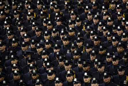 New police recruits attend the New York Police Department (NYPD)  graduation ceremony on December 29, 2015 at Madison Square Garden in New York City. More than 1,000 new graduates joined the police force.