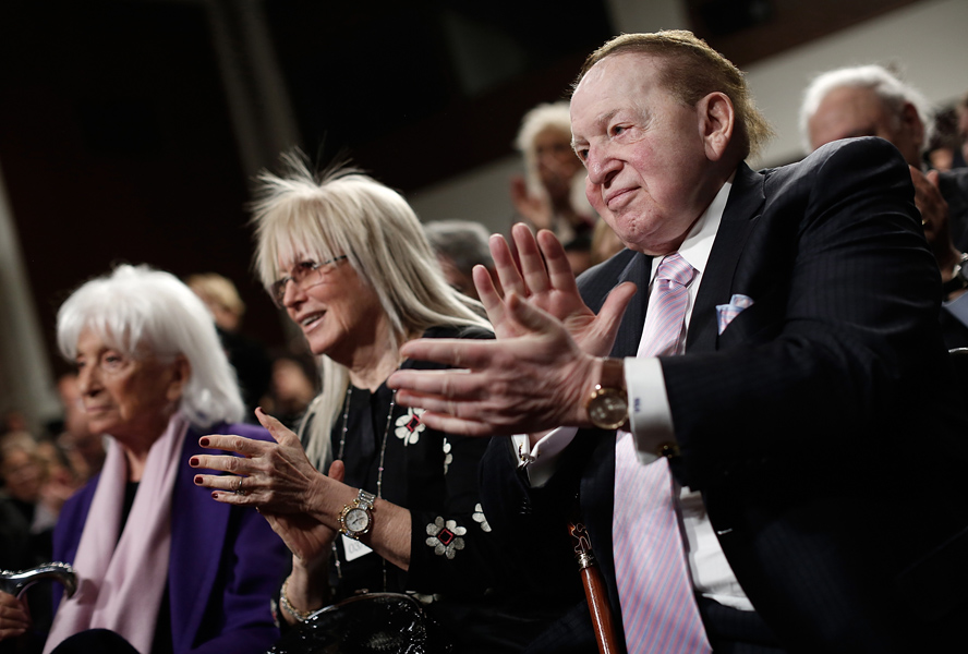 Miriam and Sheldon Adelson applaud during a discussion on a nuclear Iran with Elie Wiesel and Sen. Ted Cruz on March 2, 2015 in Washington, DC. | Credit: WIN MCNAMEE/GETTY IMAGES