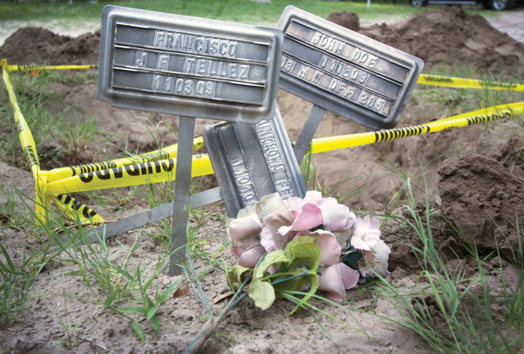 Grave markers next to a Brooks County burial plot marked for exhumation in May 2013 by the Baylor University forensics team.