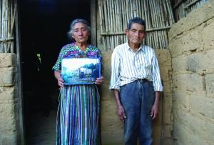 Cristina and Raymundo Coj Cumar with a photo of their son Jose Leonardo.