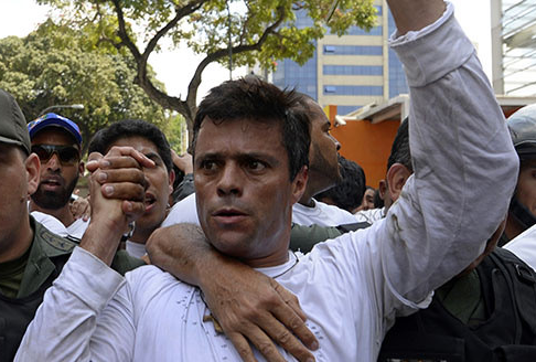 Leopoldo López is escorted by the National Guard after turning himself in during a demonstration in Caracas on February 18, 2014. | Credit: GLOBOVISIÓN/FLICKR
