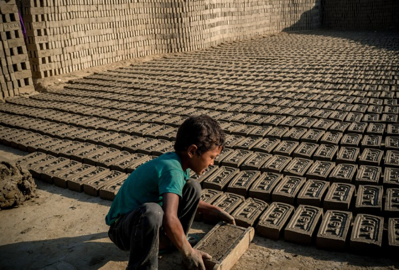 A child works at a brick factory in Kathmandu, Nepal, April 24, 2016.