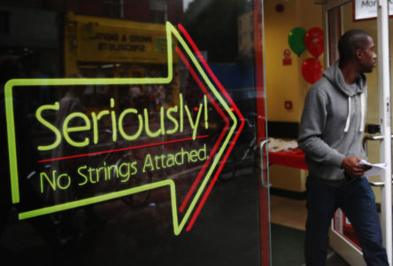 LONDON, ENGLAND - OCTOBER 03:  A man walks out of a payday loan store in Dalston on October 3, 2013 in London, England. Payday loan stores are to face tougher regulations after moves proposed by the Financial Conduct Authority (FCA) call on more responsible lending.