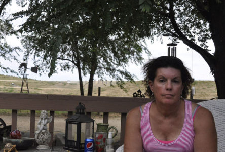 Susan, a lung cancer survivor, breathes in fumes and dust from fracking operations right near her home.