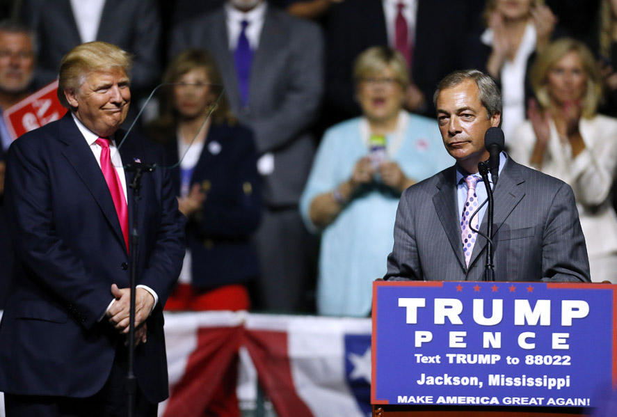 JACKSON, MS - AUGUST 24: Republican Presidential nominee Donald Trump, left,  listens to United Kingdom Independence Party leader Nigel Farage speak during a campaign rally at the Mississippi Coliseum on August 24, 2016 in Jackson, Mississippi. Thousands attended to listen to Trump's address in the traditionally conservative state of Mississippi.