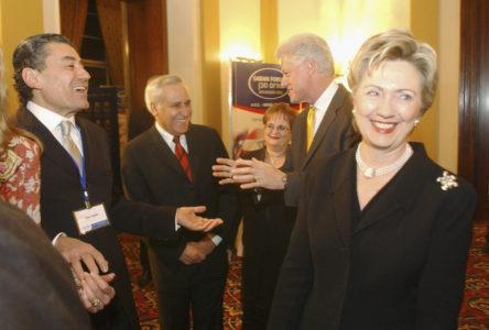 Then-Senator Hillary Clinton and Bill Clinton talk with Haim Saban and Moshe Kazav at the Saban Forum on US-Israeli Relations in Jerusalem in 2005.