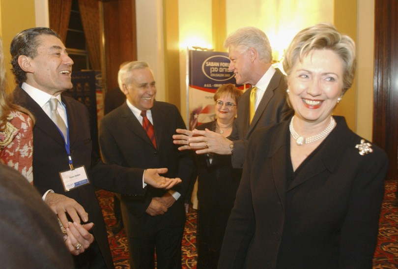 Then-Senator Hillary Clinton and Bill Clinton talk with Haim Saban and Moshe Kazav at the Saban Forum on US-Israeli Relations in Jerusalem in 2005.
