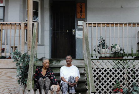Carolyn Smith, right, her mother, Gwendolyn, and their dog sit on the porch of Smith's home in Austin.