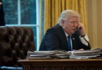 Donald Trump speaks on the phone in the Oval Office, January 28, 2017.