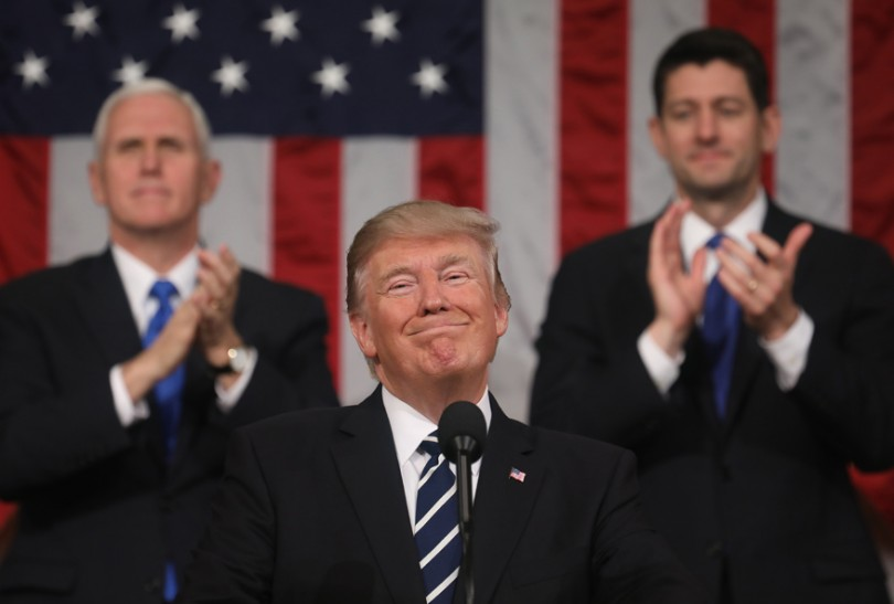 Donald J. Trump delivers his first address to a joint session of the US Congress as Vice President Mike Pence and Speaker of the House Paul Ryan listen, February 28, 2017.