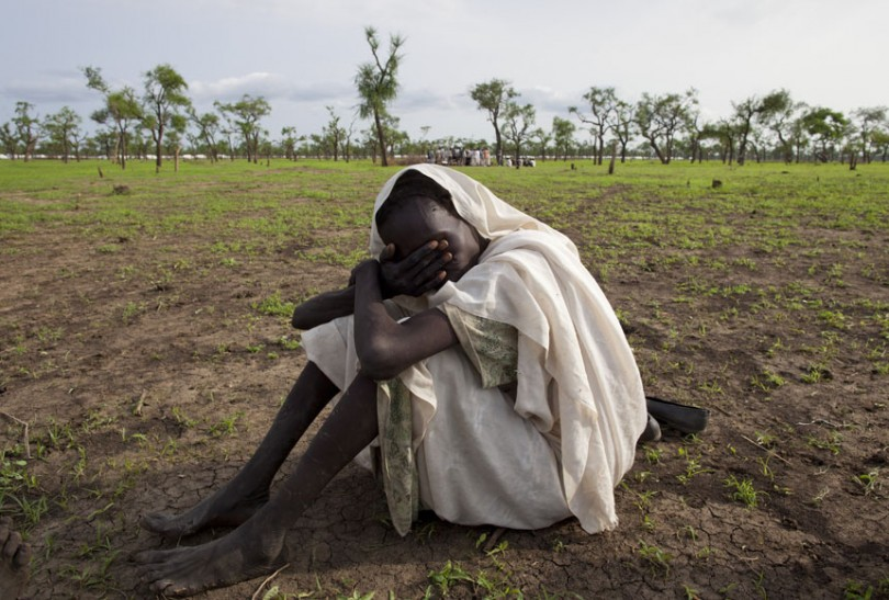 A woman grieves the death her husband in Jamam refugee camp in 2012.