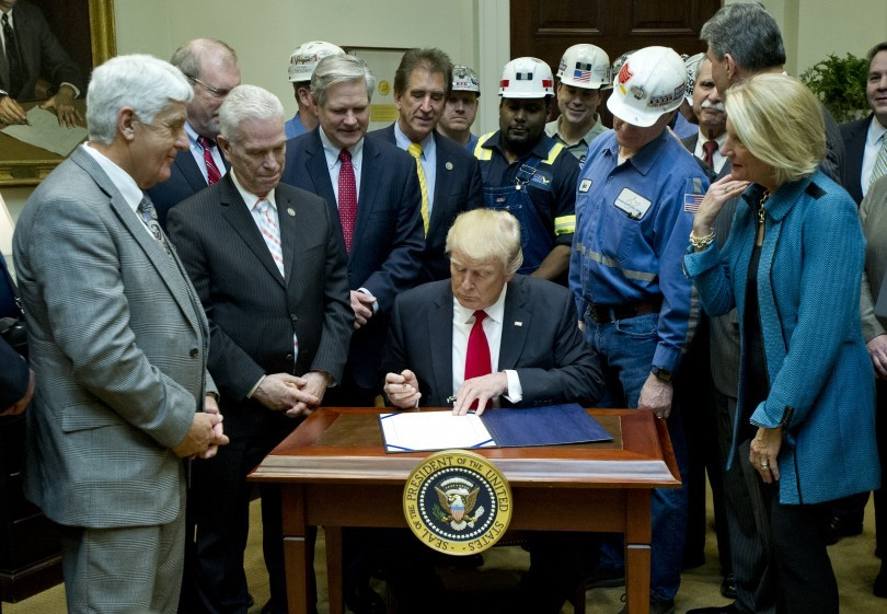 President Donald Trump signs H.J. Res. 38, disapproving the Department of Interior's Stream Protection Rule, which was signed during the final month of the Obama administration.