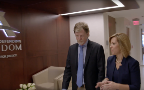 Jack Phillips, owner of Masterpiece Cakeshop, and his attorney, Kristen Waggoner, walk through the lobby of an ADF office.