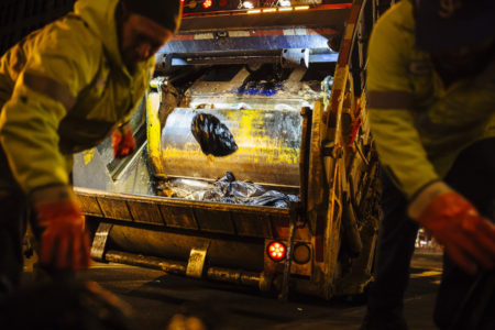 By day, New York's residential garbage is picked up by municipal workers. But come nightfall, private haulers collect the commercial trash, often working at breakneck speeds with few protections for workers.